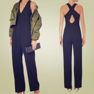 Intermix black deep v cross back jumpsuit